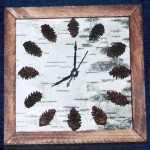 View and buy this Birch Bark / Pine Cone Clock